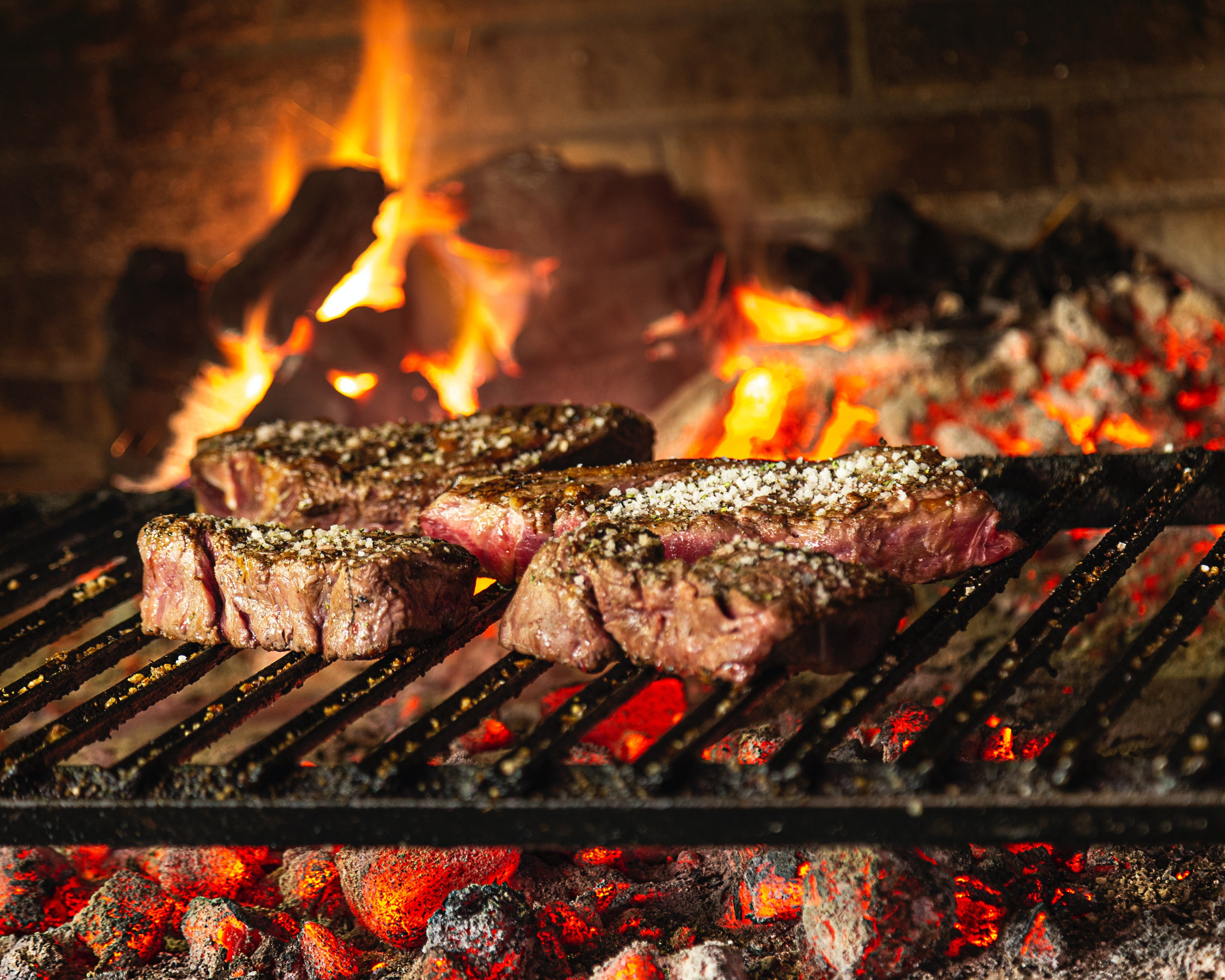Pictured - Grilled meat on a charcoal grill | Source: Pexels