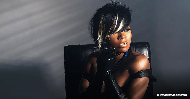 Fantasia Is a Sight to Behold in Revealing Black Outfit with Leather Gloves & High-Heeled Boots