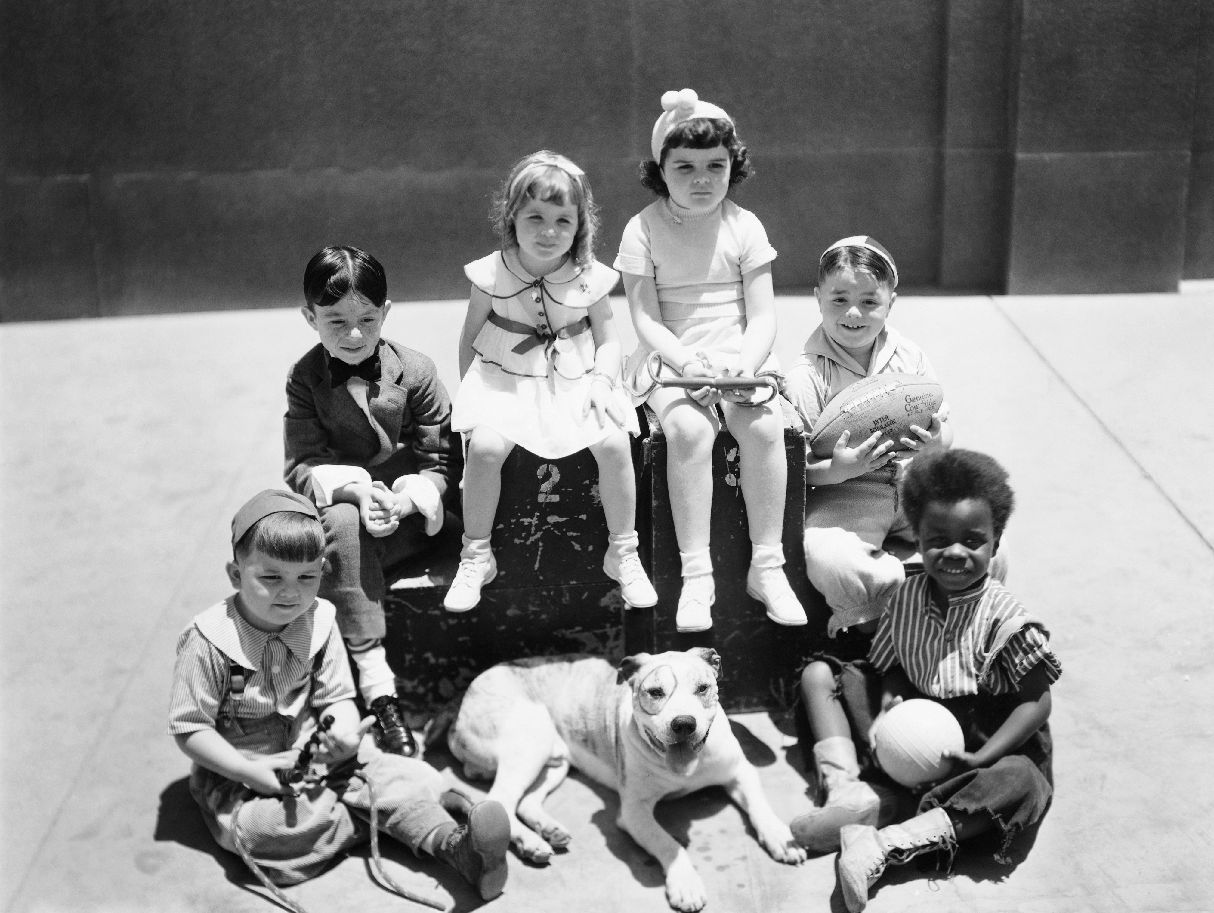"""The cast of """"Our Gang/Little Rascals"""" TV show, Hal Roach, MGM production. Spanky McFarland holding the football. Undated photograph. 