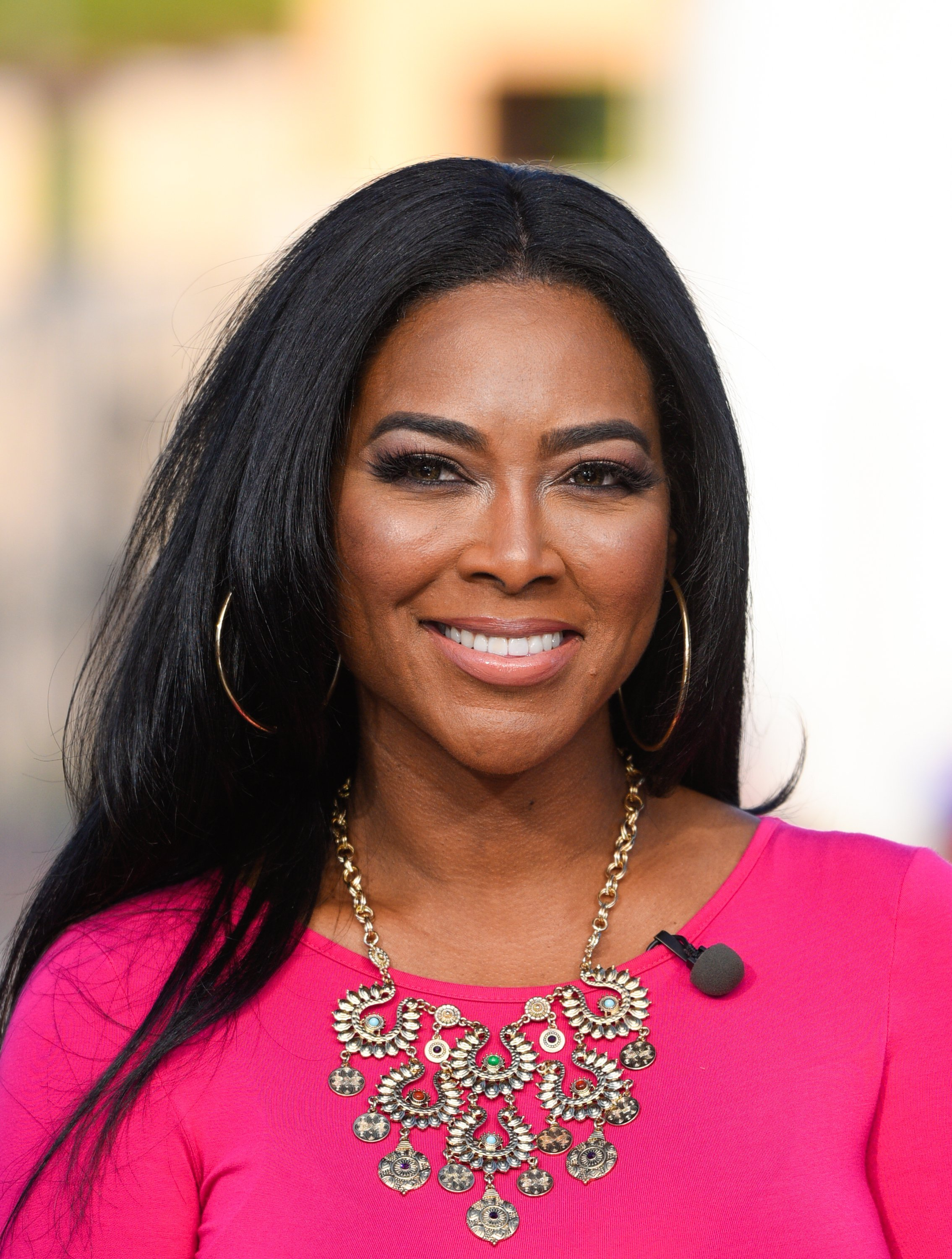 "Kenya Moore visits ""Extra"" in January 2015. 