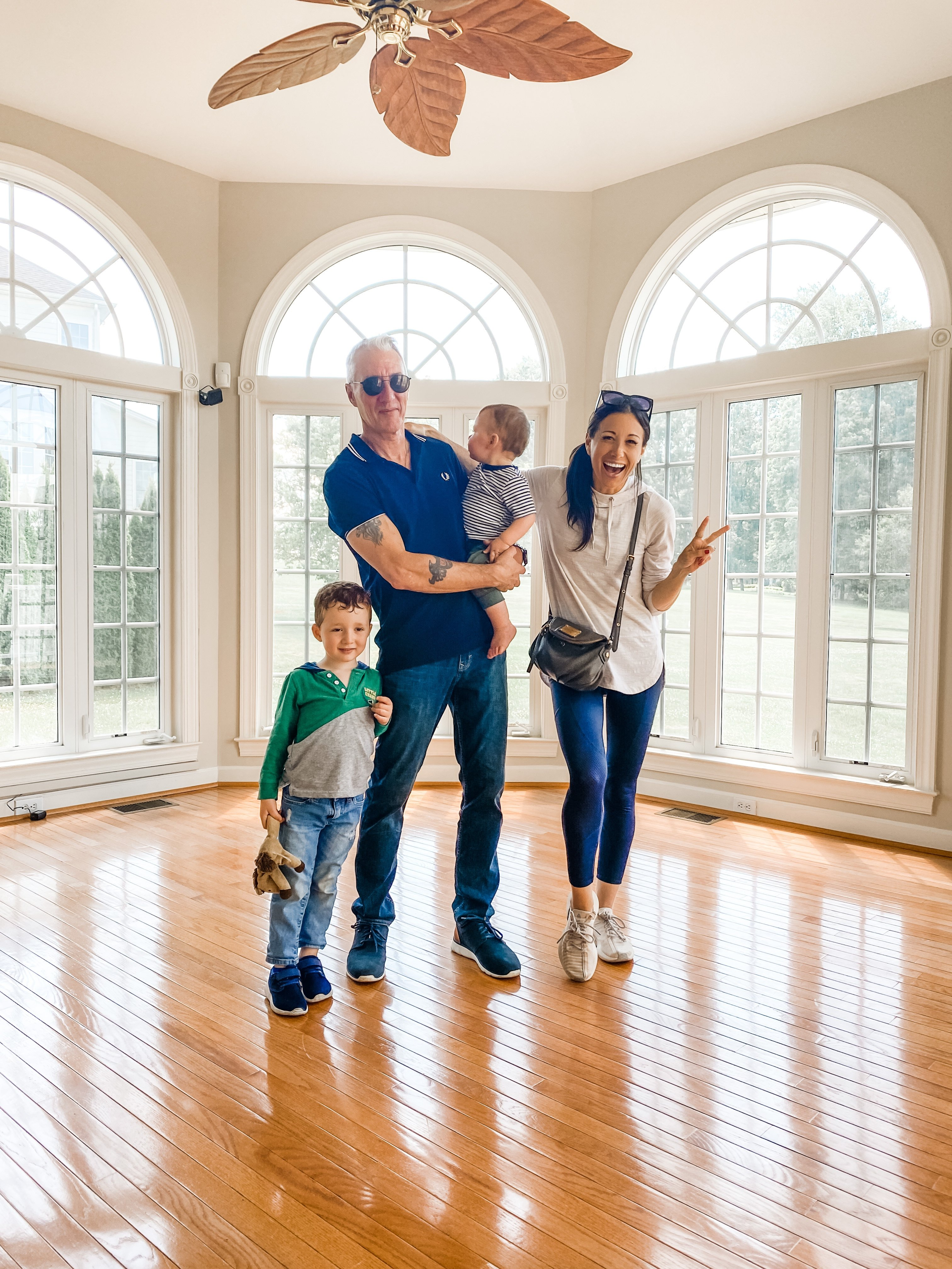 George and Jamie Hess' family at their new house | Photo: Courtesy of Jamie Hess