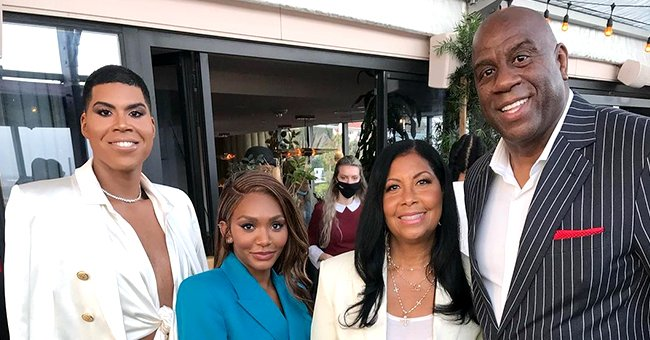 Magic Johnson's Son EJ Sports a Satin Top & Jacket Ensemble with a Gold Slit Skirt at His Sister's Party