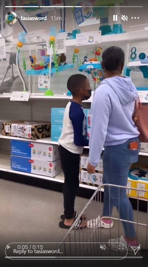Fantasia Barrino and son Dallas Xavier looking at baby chairs at a store. | Photo: Instagram/tasiasword
