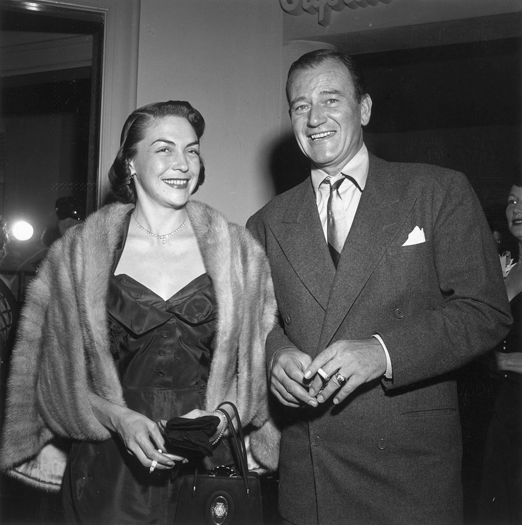 John Wayn and his second wife Esperanza Bauer at a party for American comedian Red Skelton's television debut on January 01, 1951, Hollywood, California   Photo: Getty Images