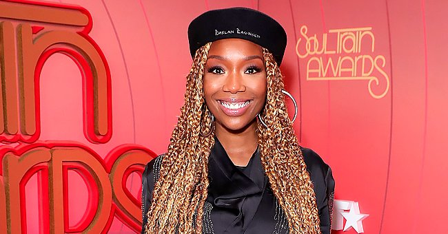 Brandy Turns Heads Showing Her Long Black Braids in a $675 Sepia Shirelle Jumpsuit (Photo)