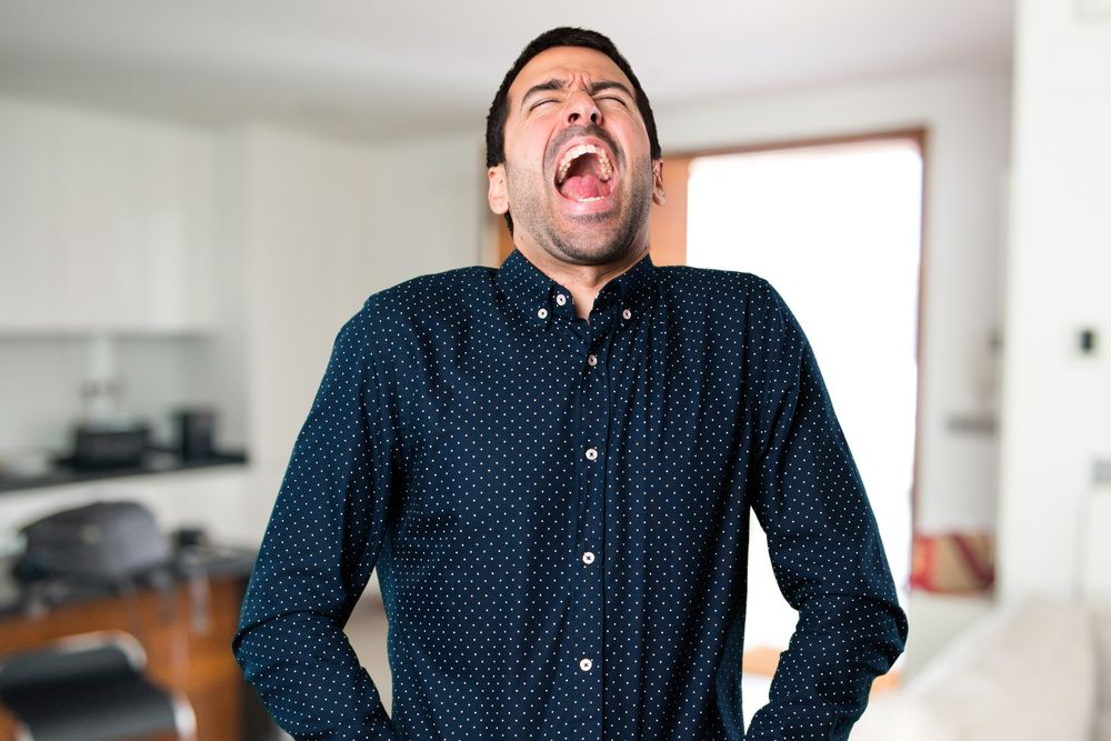 A man who is about to scream. | Source: Shutterstock