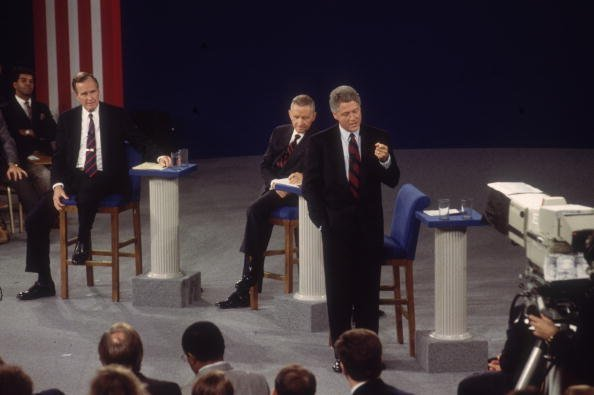 George H. W. Bush, Ross Perot, and Bill Clinton during the second presidential debate on October 15, 1992 | Source: Getty Images/Global Images Ukraine