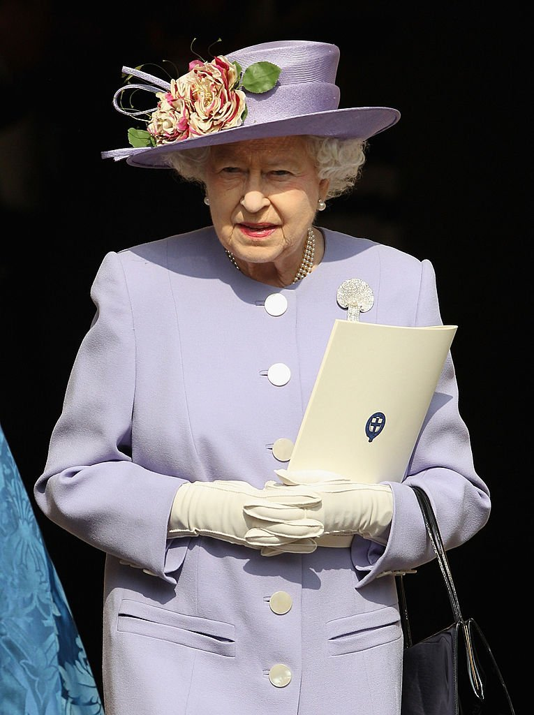 Queen Elizabeth II leaves a thanksgiving service for a thanksgiving service for the Queen Mother and Princess Margaret at St George's Chapel on March 30, 2012, in Windsor, England. | Source: Getty Images.