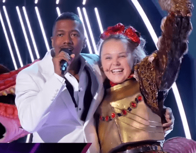 """JoJo Siwa revealed to be the T-Rex on """"The Masked Singer"""" on March 25, 2020.   Source: YouTube/ The Masked Singer."""