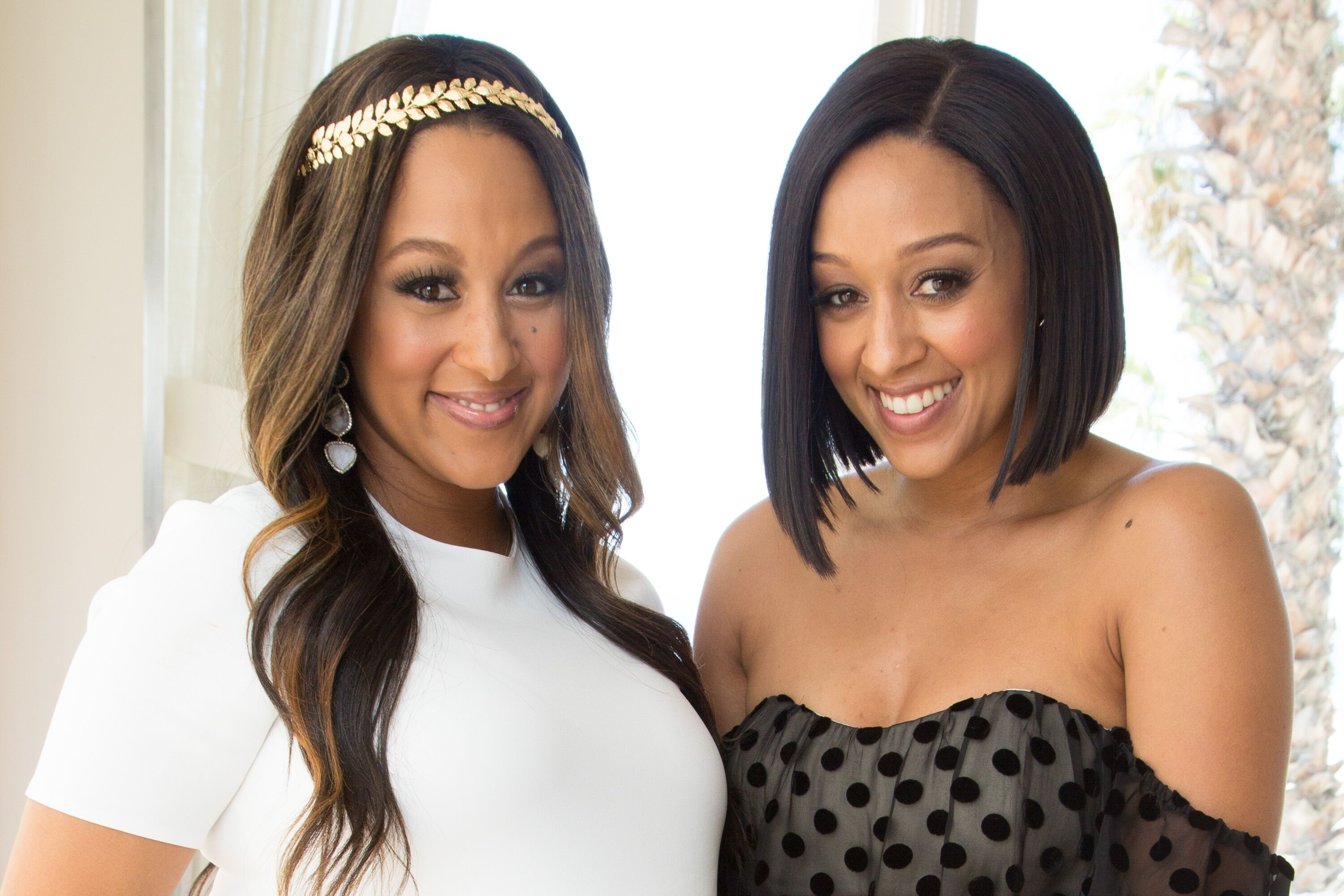 Tamera Mowry-Housley (L) and Tia Mowry attend Tamera Mowry-Housley's baby shower at Casa Del Mar on April 4, 2015 in Santa Monica, California. | Source: Getty images
