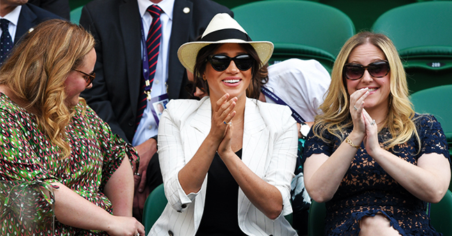Meghan Markle Looks Chic in a $640 White Blazer and Blue Jeans at Wimbledon