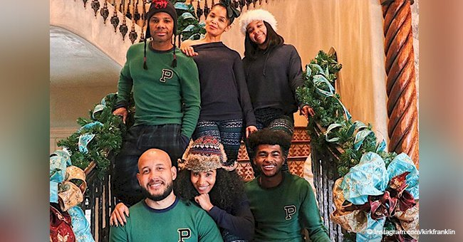 Kirk Franklin poses with his wife & grown kids in matching pajamas for Christmas photo