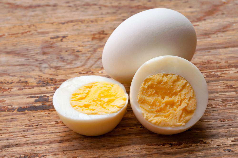 Two boiled eggs and one is cut in half. | Photo: Shutterstock