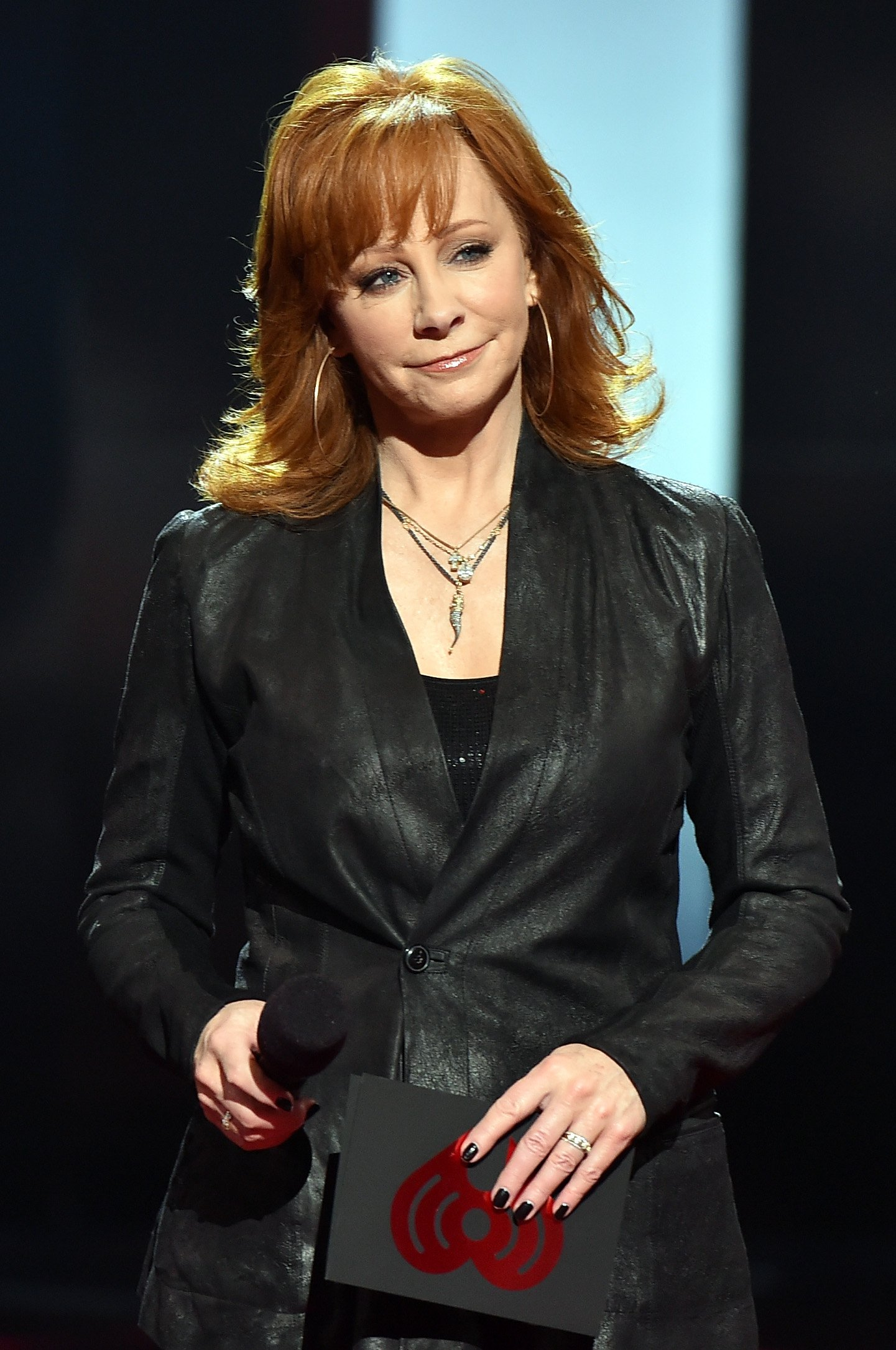 Reba McEntire speaks onstage during the 2015 iHeartRadio Music Awards. | Photo: Getty Images