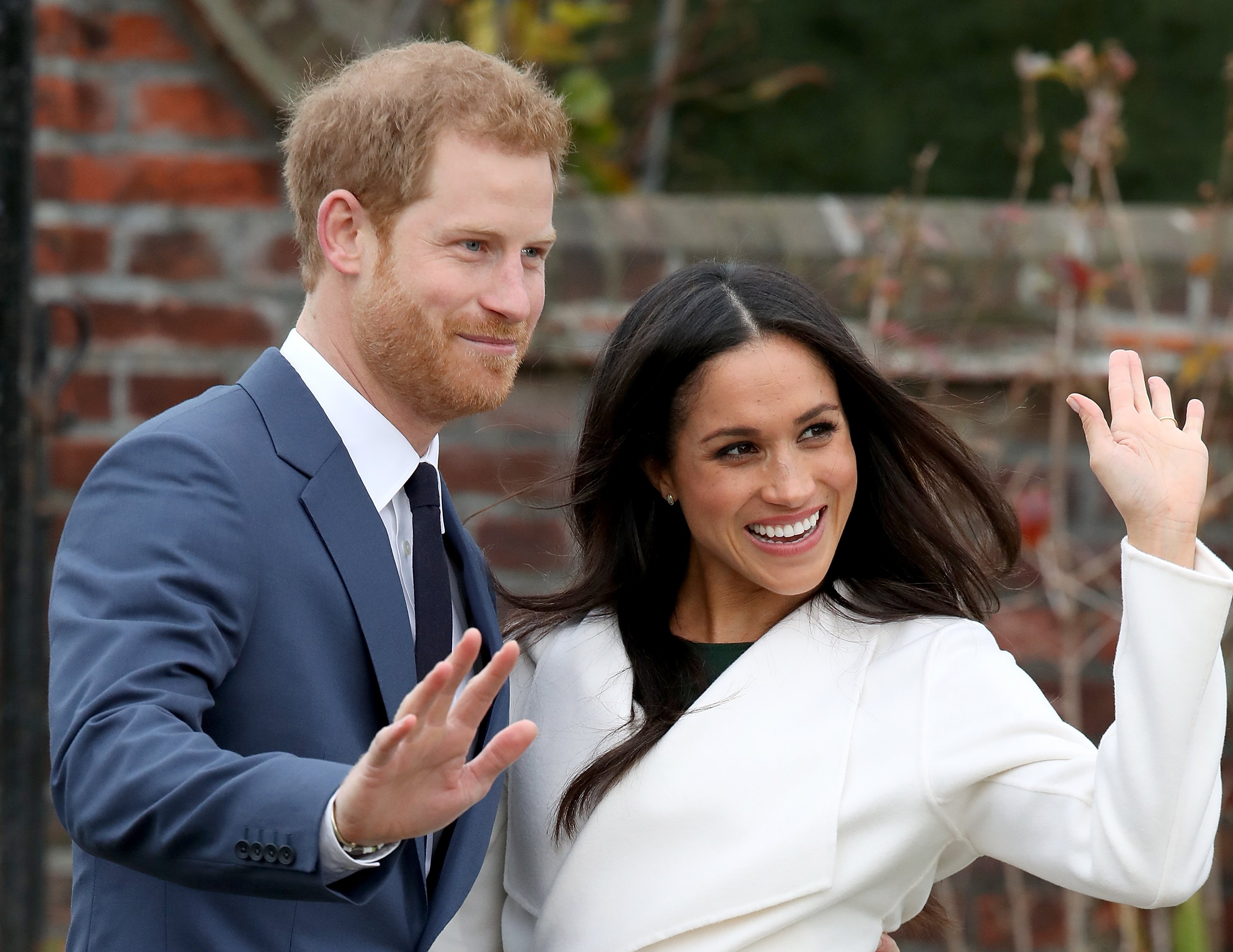 Prince Harry and Meghan Markle during an official photocall to announce their engagement at The Sunken Gardens at Kensington Palace on November 27, 2017. | Photo: Getty Images