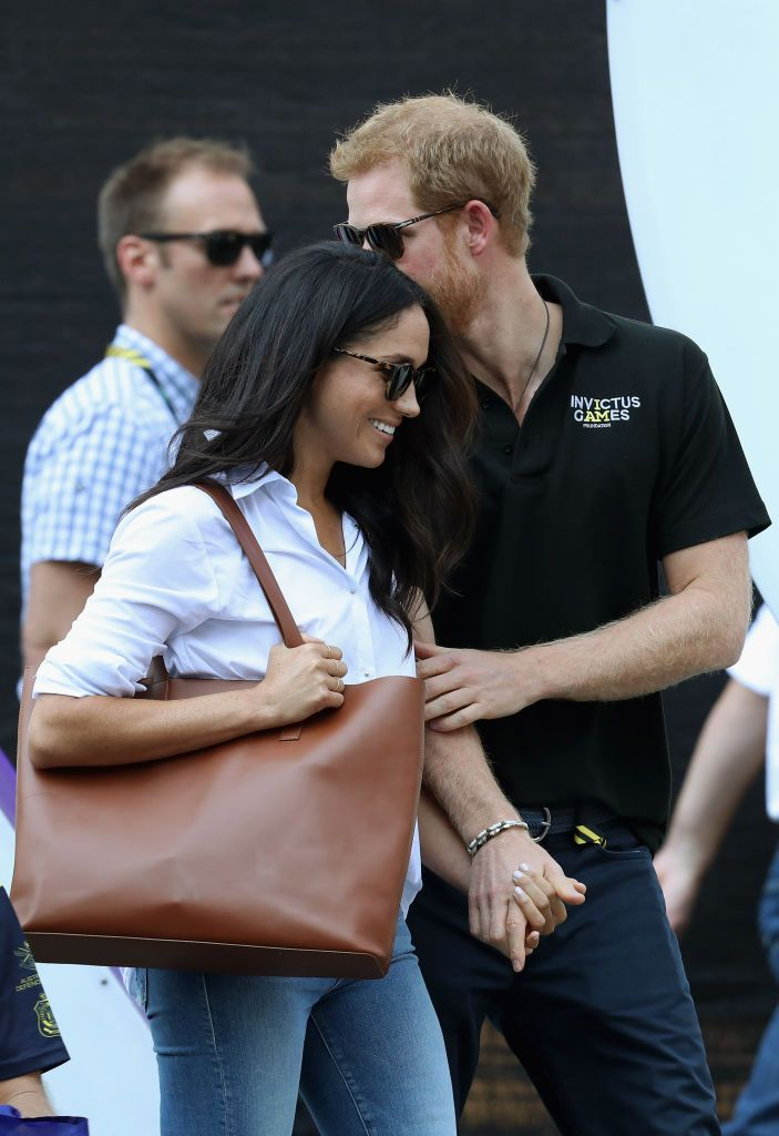 Prince Harry and Meghan Markle hold hands during the Invictus Games 2017 at Nathan Philips Square on September 25, 2017 in Toronto, Canada. | Photo: Getty Images.