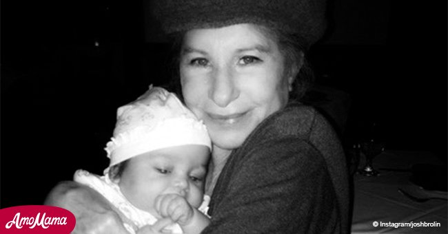 Powerhouse actress and singer Barbra Streisand, 76,  poses with cute baby in a fantastic photo
