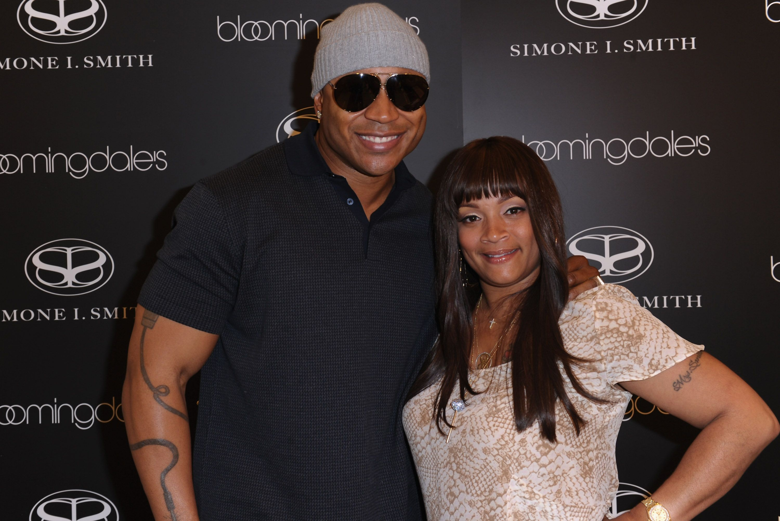 Actor LL Cool J and Simone I. Smith attend a personal appearance by Simone I. Smith at Bloomingdale's on May 12, 2011 in Century City, California | Photo: Getty Images