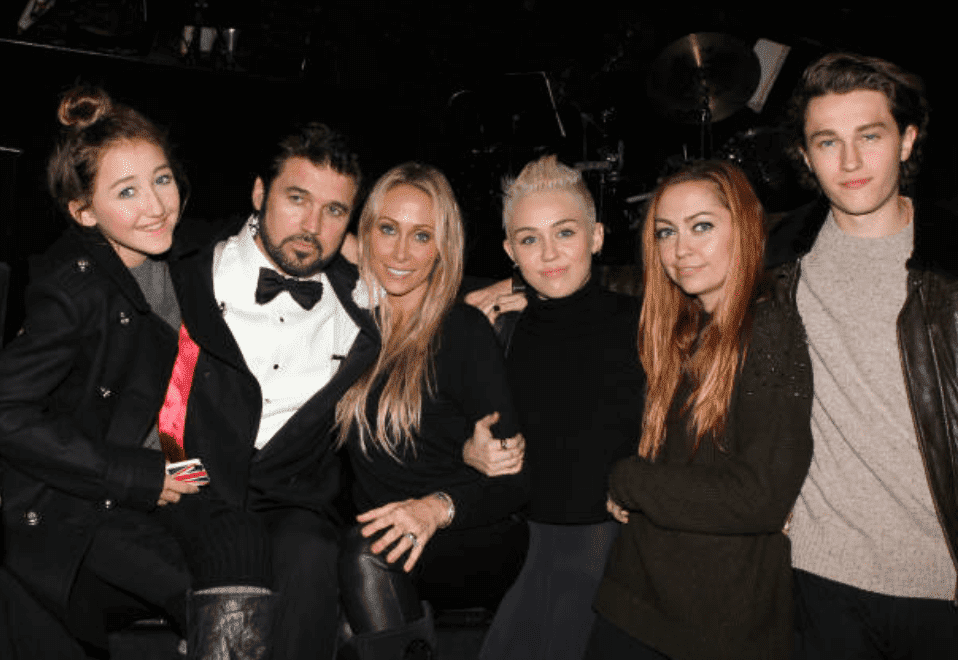 "Billy Ray Cyrus, Tish Cyrus, Miley Cyrus, Noah Cyrus, Brandi Cyrus and Braison Cyrus poses as a family backstage at a showing for the musical ""Chicago,"" on November 18, 2012, New York City 