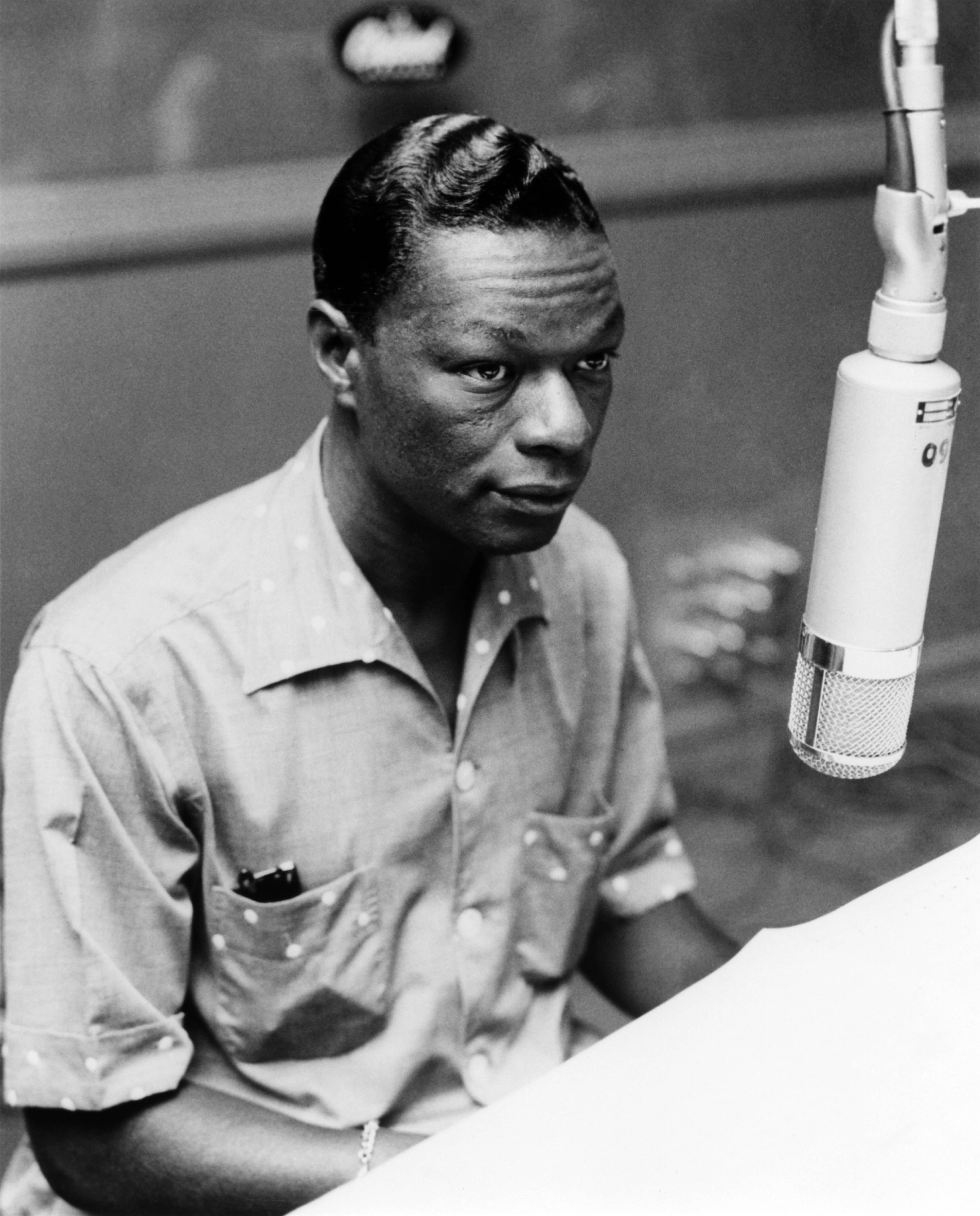 Photo of Nat King COLE; Nat King Cole playing the piano in the recording studio   Photo: Getty Images
