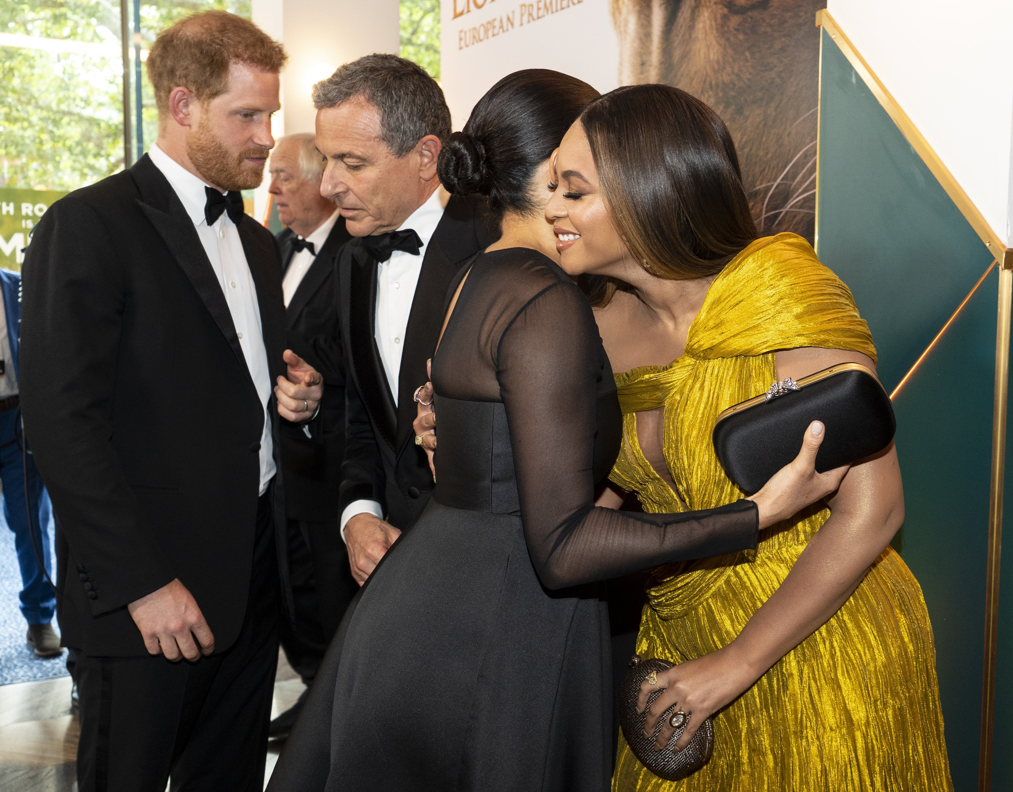 """Meghan Markle and Beyonce Knowles embrace at """"The Lion King"""" premiere in London on Sunday, July 14 