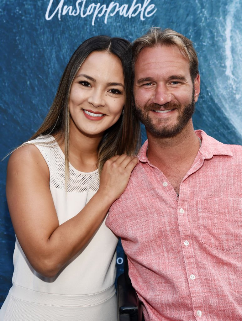 """Nick Vujicic and Kanae Vujicic arrive at the Los Angeles Premiere of the Entertainment Studios documentary """"Bethany Hamilton: Unstoppable"""" at the ArcLight Hollywood on July 09, 2019 in Hollywood, California. 