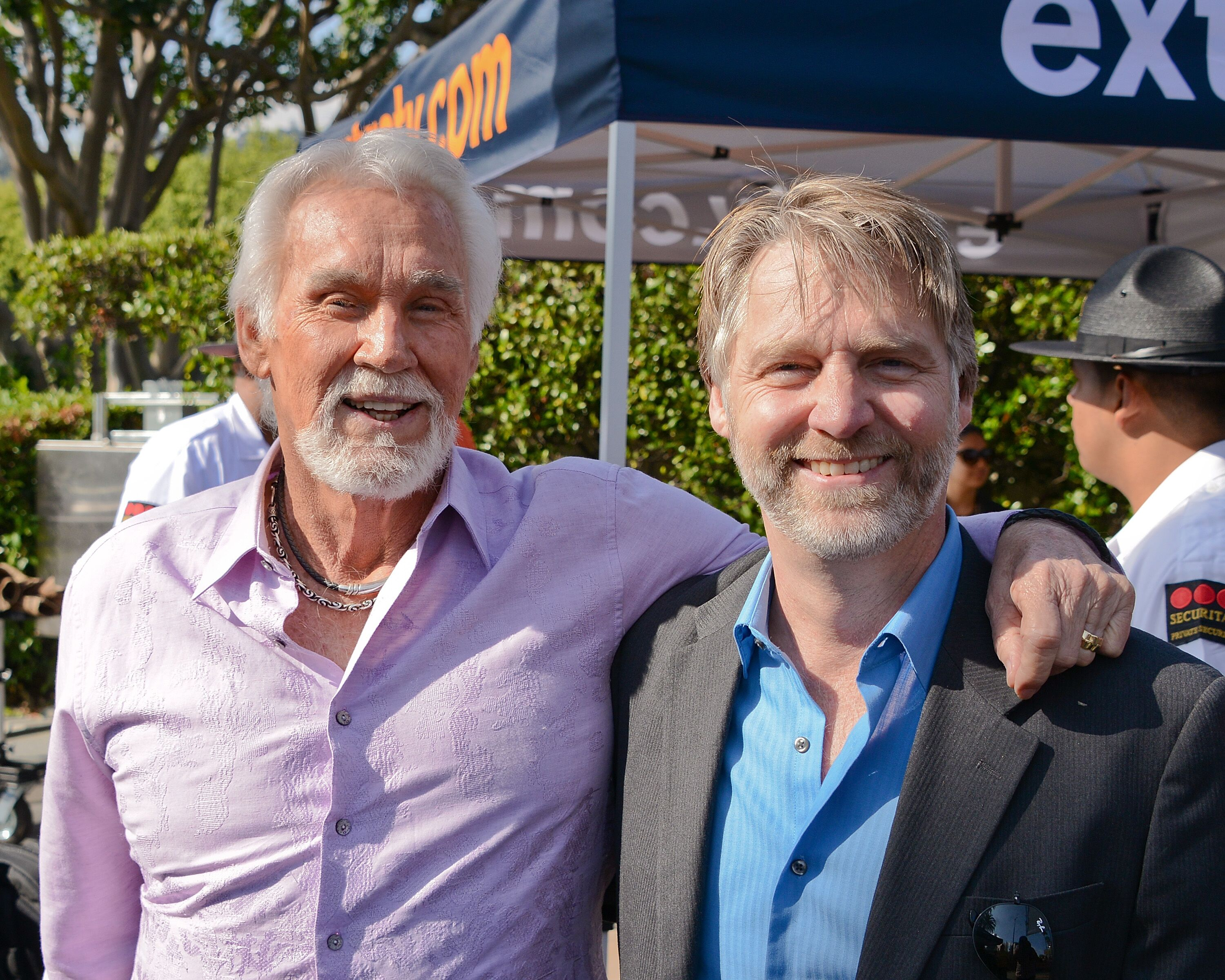 Kenny Rogers and his son actor Kenny Rogers Jr at Universal Studios Hollywood in 2013 | Source: Getty Images