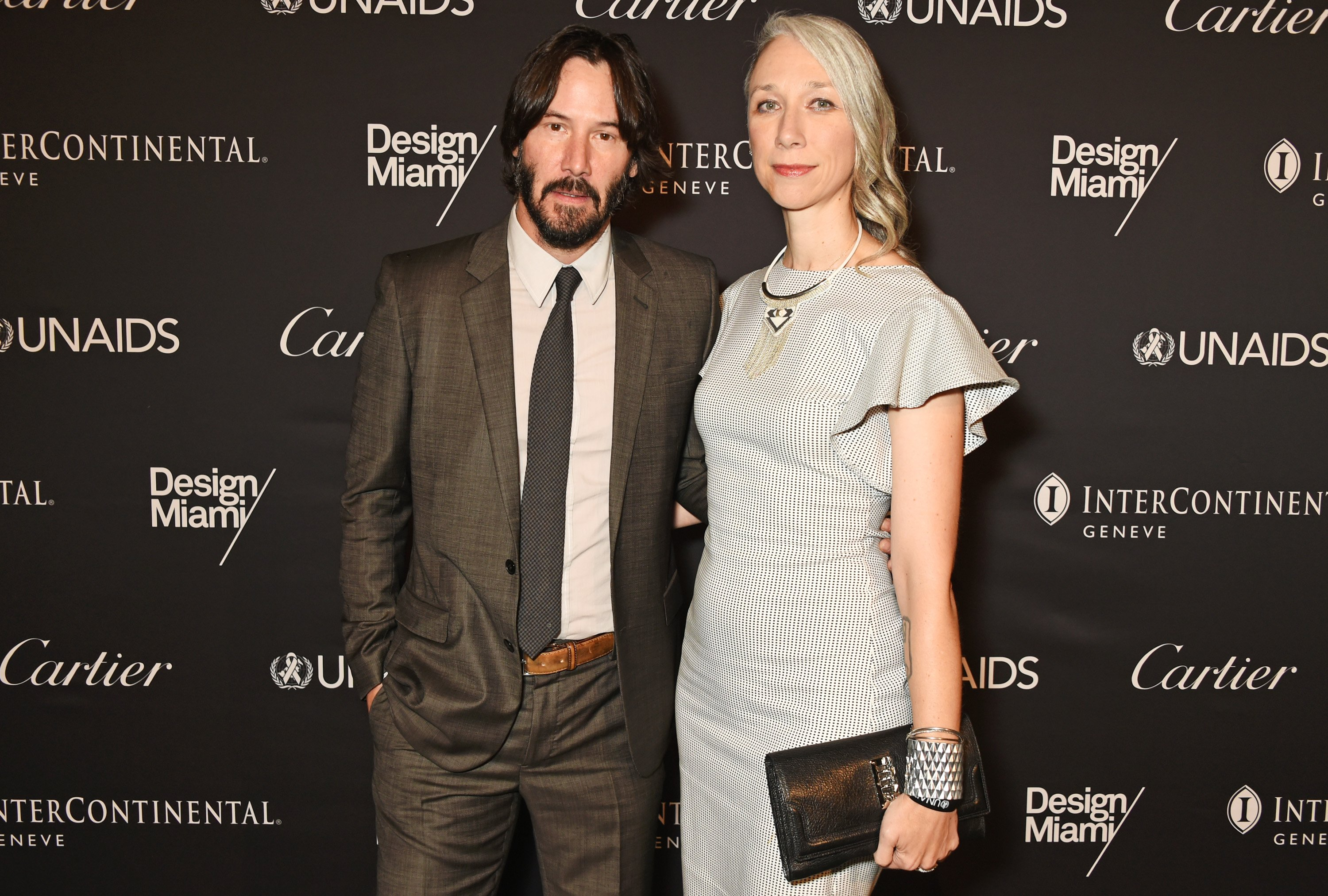 Keanu Reeves (L) and artist Alexandra Grant attend the UNAIDS Gala during Art Basel 2016 at Design Miami/ Basel on June 13, 2016, in Basel, Switzerland. | Source: Getty Images.