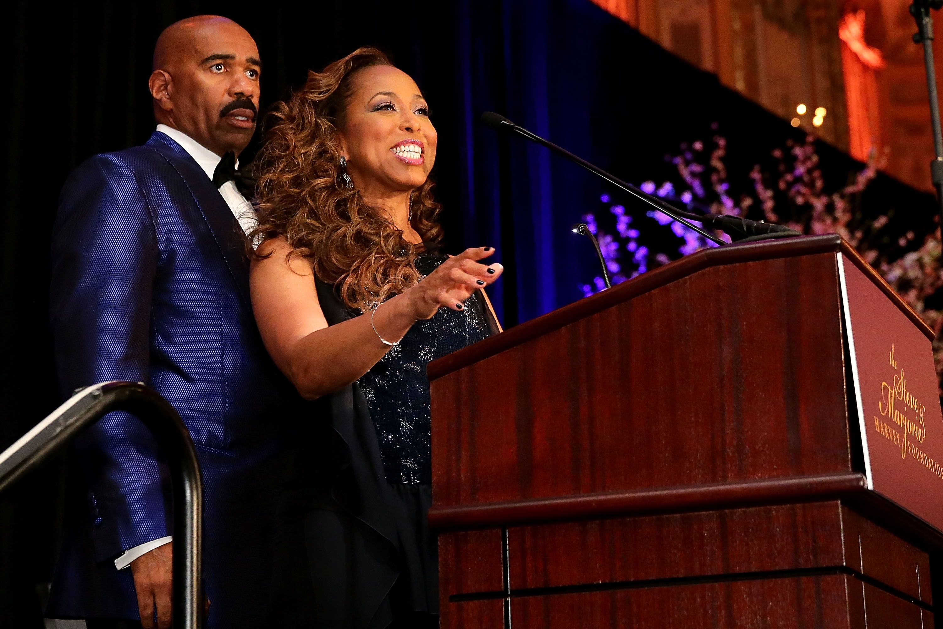 Steve and Marjorie Harvey on stage at the 2014 Steve & Marjorie Harvey Foundation Gala   Source: Getty Images