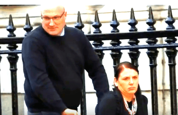 Kerry Shaw's husband pushing her in a wheelchair.   Source: YouTube/TV ATwood