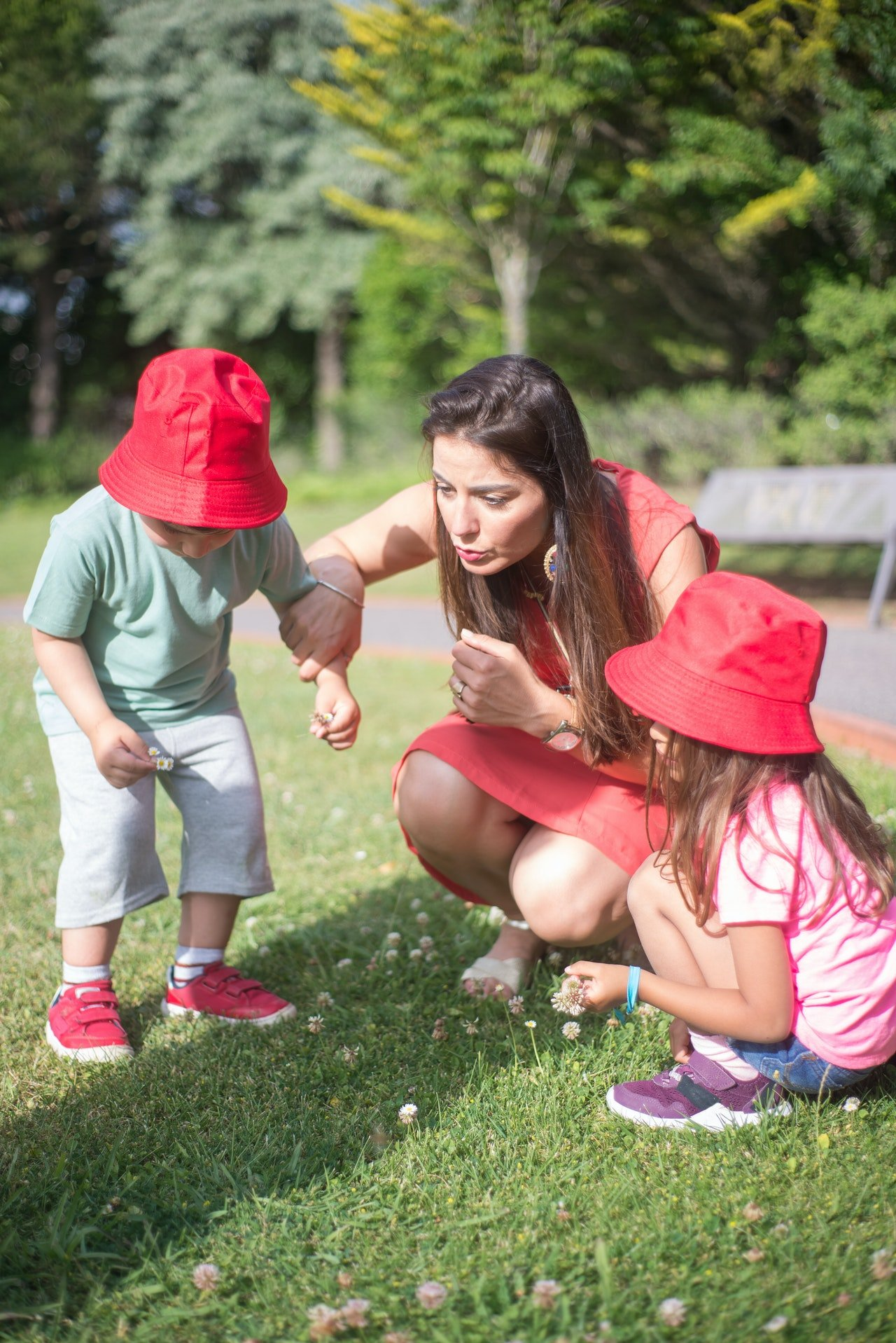Woman having fun and playing with kids   Photo: Pexels