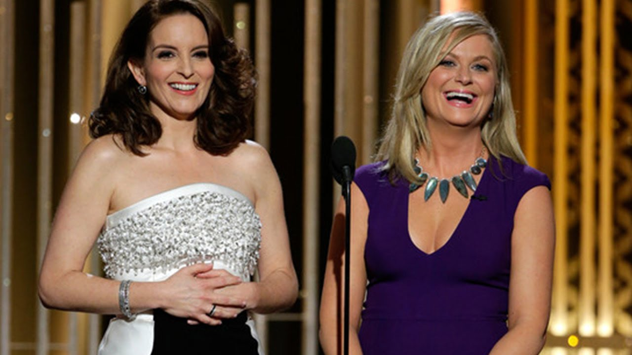 Hosts Tina Fey and Amy Poehler speak onstage during the 72nd Annual Golden Globe Awards at The Beverly Hilton Hotel on January 11, 2015 in Beverly Hills, California | Photo: YouTube/InformOverload