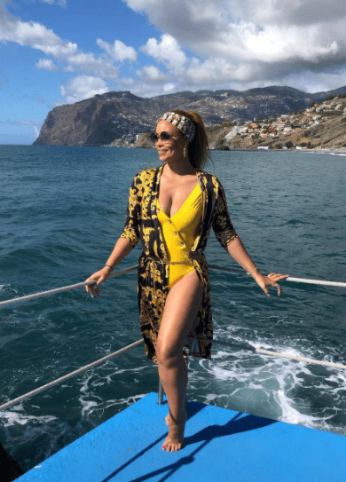 RHOP star Gizelle Bryant in a bright yellow swimsuit during a trip to Portugal. | Photo: instagram.com/gizellebryant