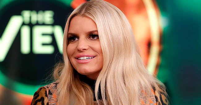 Jessica Simpson Gets Candid about Eczema Showing Her Slim Waist in Chic Jeans & a Denim Blouse