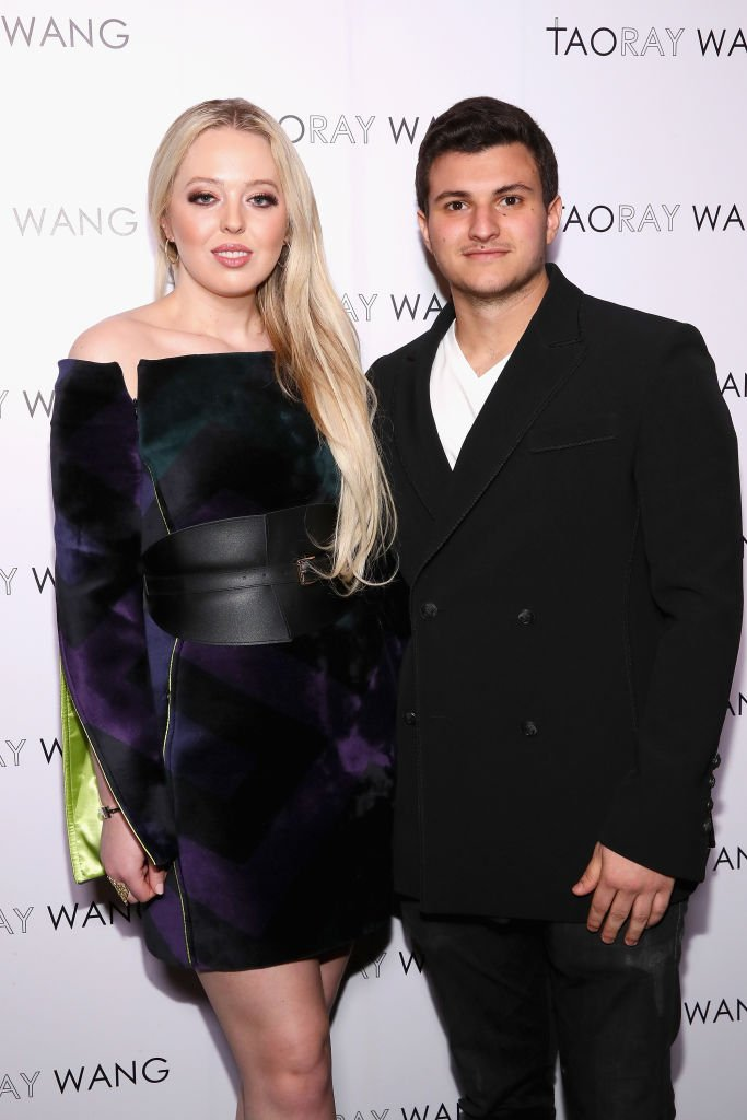 Tiffany Trump (L) and Michael Boulos pose backstage for Taoray Wang fashion show during New York Fashion Week: The Shows at Gallery II at Spring Studios | Photo: Getty Images