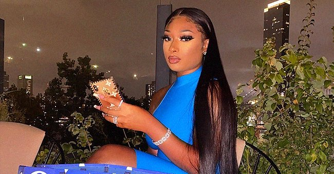 Check Out the Blue Louis Vuitton Handbag Megan Thee Stallion Paired with a Matching Tight Dress