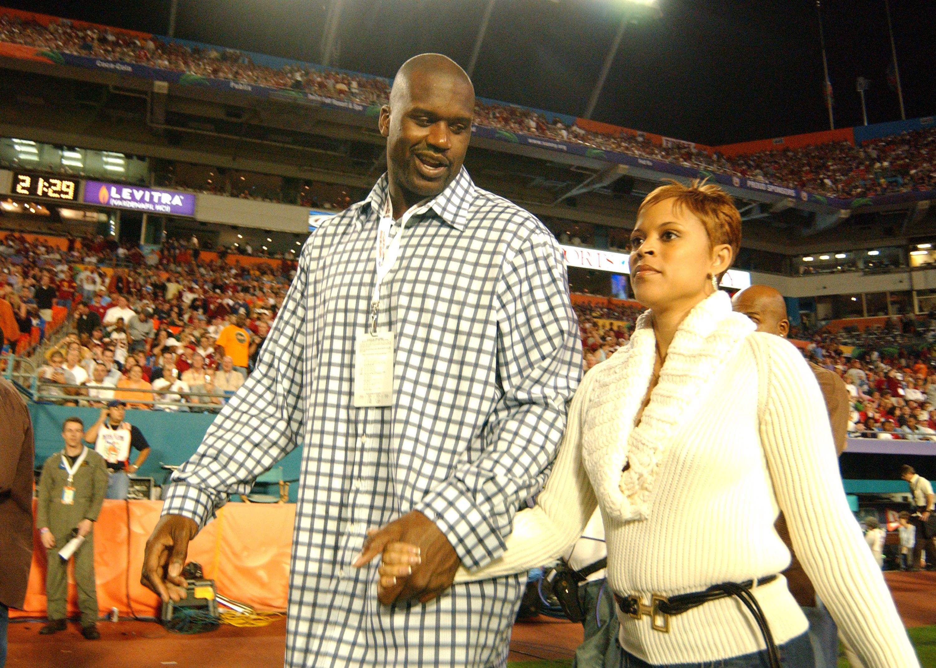 Shaquille O'Neal and wife Shaunie attend the FedEx Orange Bowl National Championship at Pro Player Stadium in Miami, Florida on January 4, 2005.   Source: Getty Images