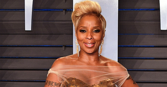 Mary J. Blige Busts a Move in Orange Thigh-High Boots & Matching Jacket during 'Royalty' Tour