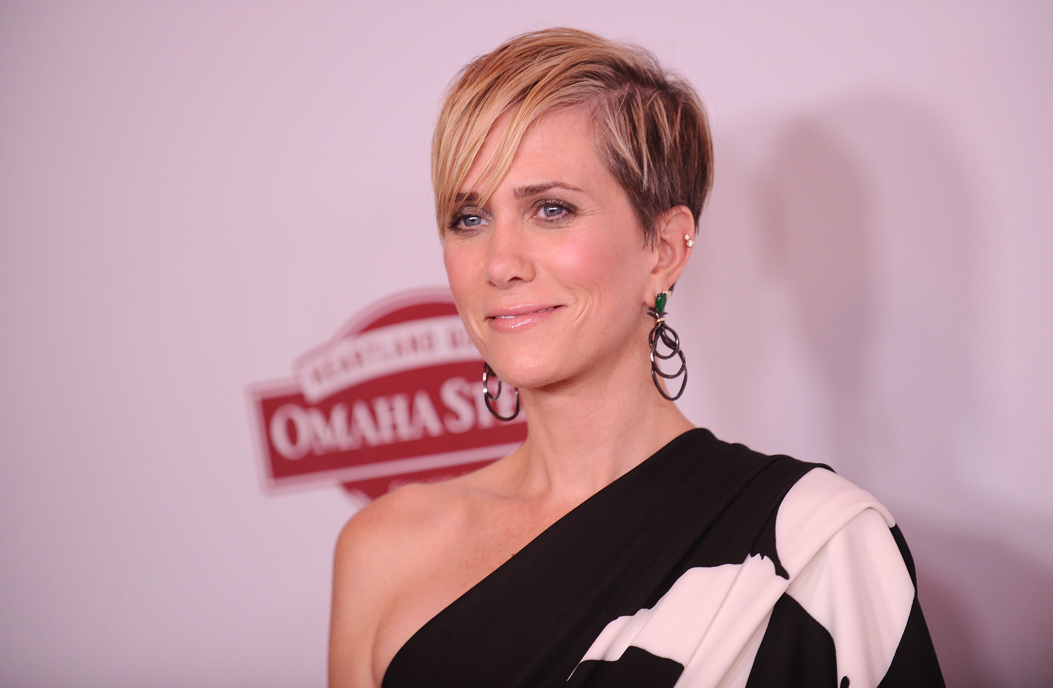 """Kristen Wiig pictured at the premiere of """"Downsizing"""" at Regency Village Theatre, 2017, California. 