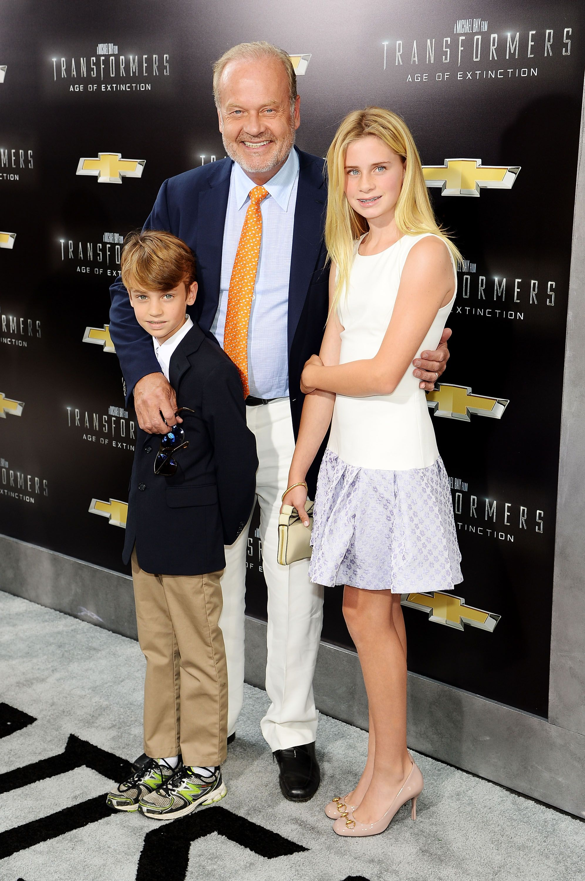 """Kelsey Grammer with children Mason and Jude at the premiere of """"Transformers: Age Of Extinction"""" in 2014 in New York 