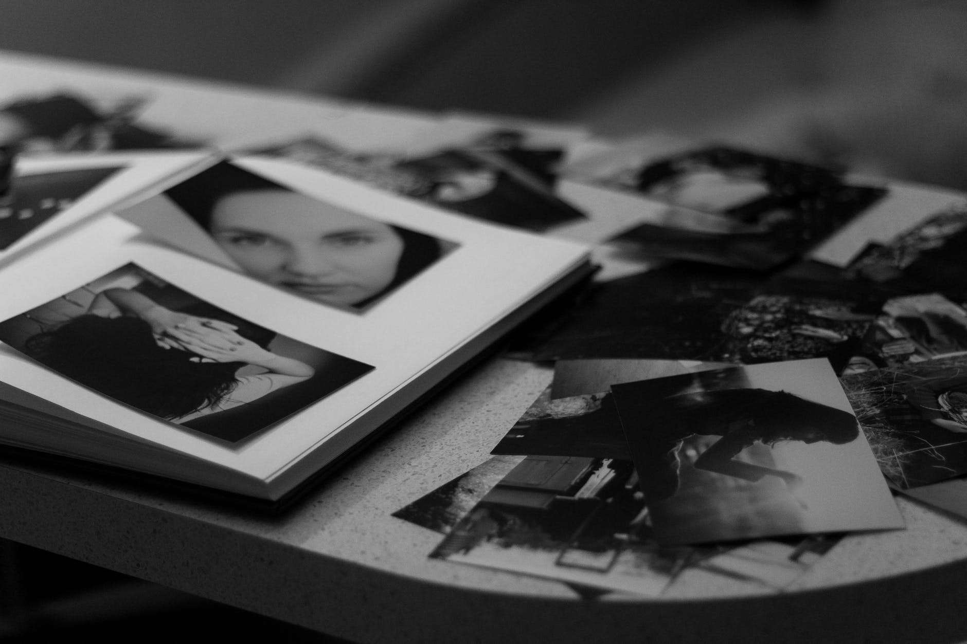 She looked through her photo album.   Source: Pexels