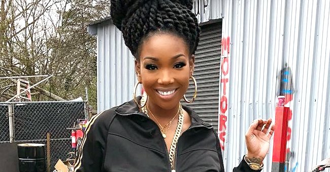 Brandy Flaunts Her Curves in a Red Givenchy Bodysuit and Pants in Photo