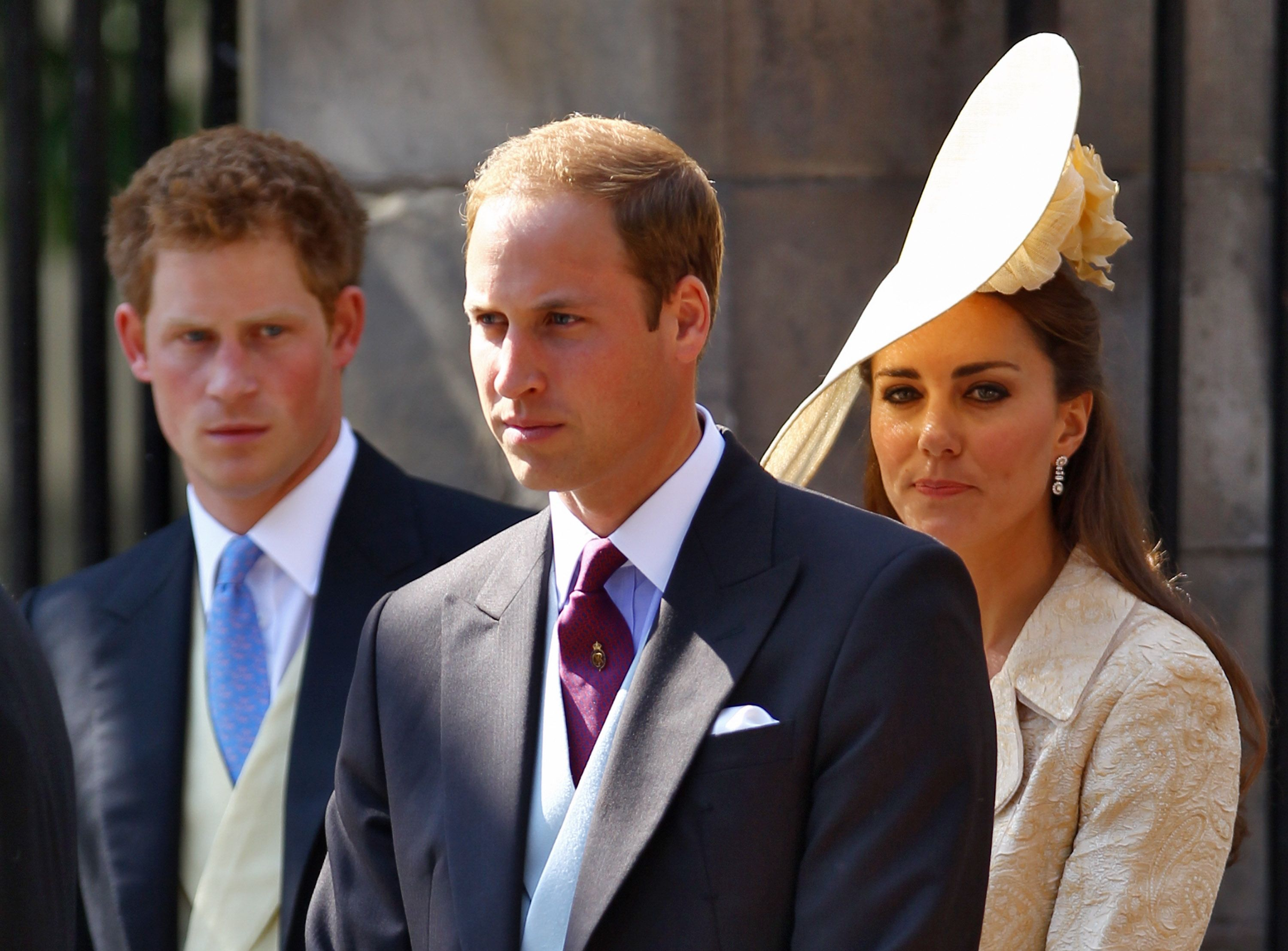 Prince Harry, Prince William, and Duchess Kate depart after the royal wedding of Zara Phillips and Mike Tindall on July 30, 2011, in Edinburgh, Scotland | Photo: Jeff J Mitchell/Getty Images