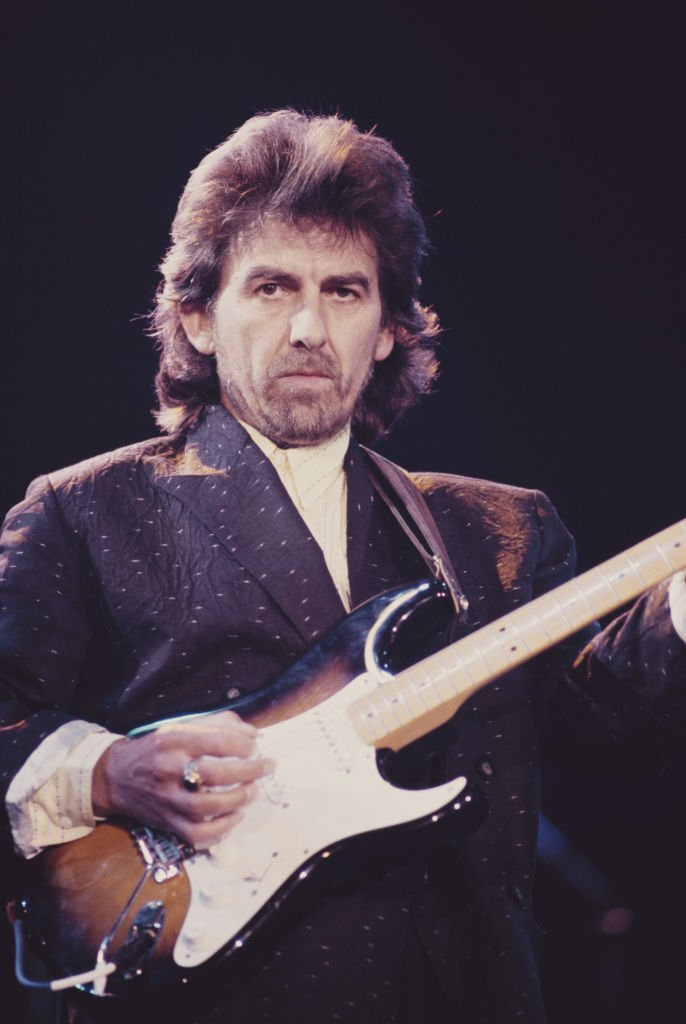 Former Beatle George Harrison (1943 - 2001) performing with a Fender Stratocaster guitar at the Prince's Trust Concert, Wembley Arena, London, | Getty Images / Global Images Ukraine