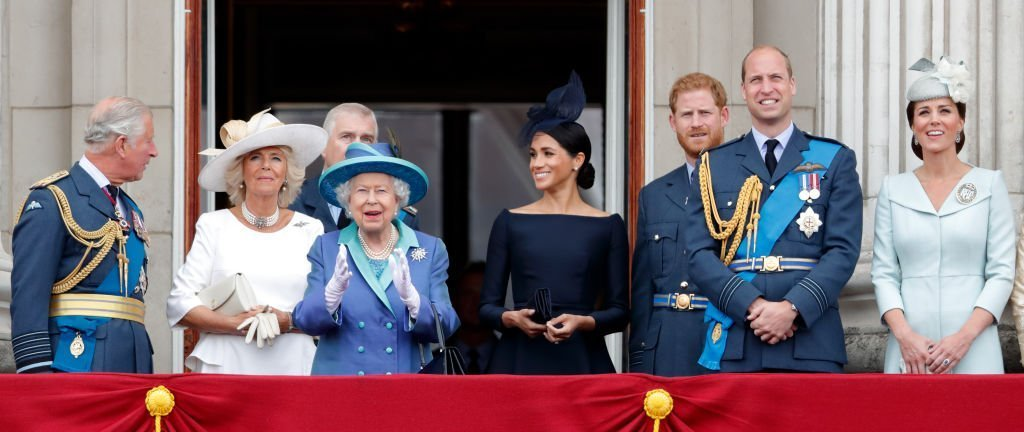 Prince Charles, Prince of Wales, Camilla, Duchess of Cornwall, Prince Andrew, Duke of York, Queen Elizabeth II, Meghan, Duchess of Sussex, Prince Harry, Duke of Sussex, Prince William, Duke of Cambridge and Catherine, Duchess of Cambridge watch a flypast to mark the centenary of the Royal Air Force from the balcony of Buckingham Palace. | Photo: Getty Images