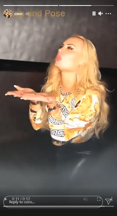 A screenshot from a clip of Coco Austin dancing at the club in her Versace top.   Photo: Instagram.com/Coco