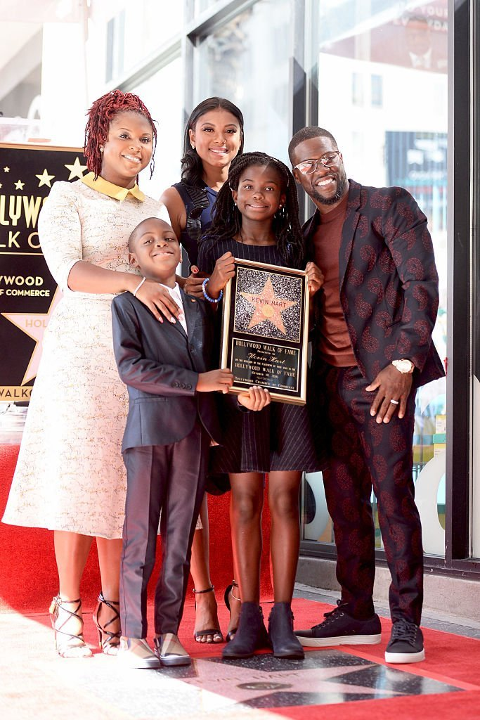 Kevin Hart is joined by his wife,Eniko Parish, ef-wife, Torrei hart and children Hendrix and Heaven Hart when he was honored with a star on the Hollywood Walk of Fame in October 2016. | Photo: Getty Images
