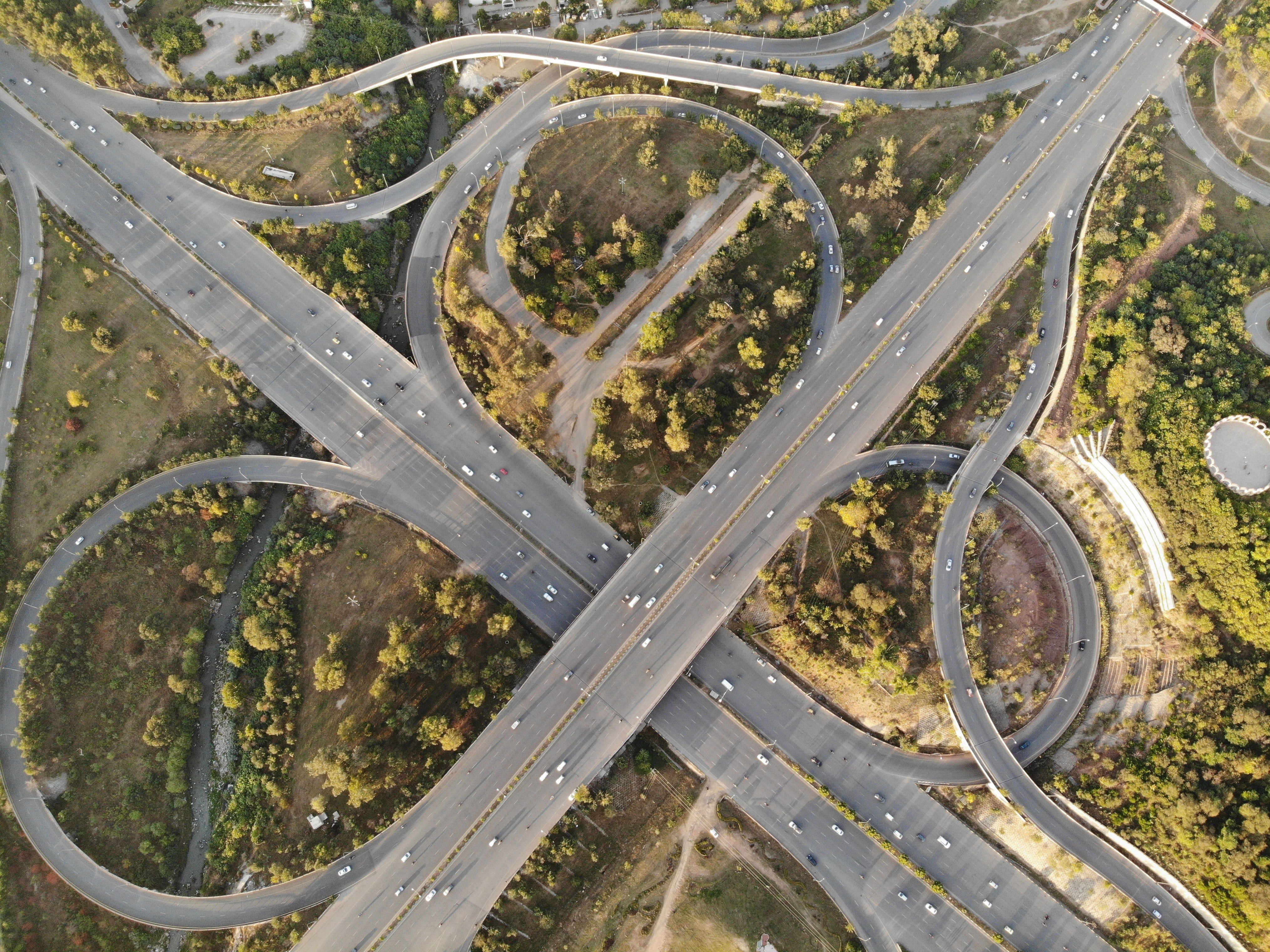 Pictured - An aerial photograph of a concrete road   Source: Pexels
