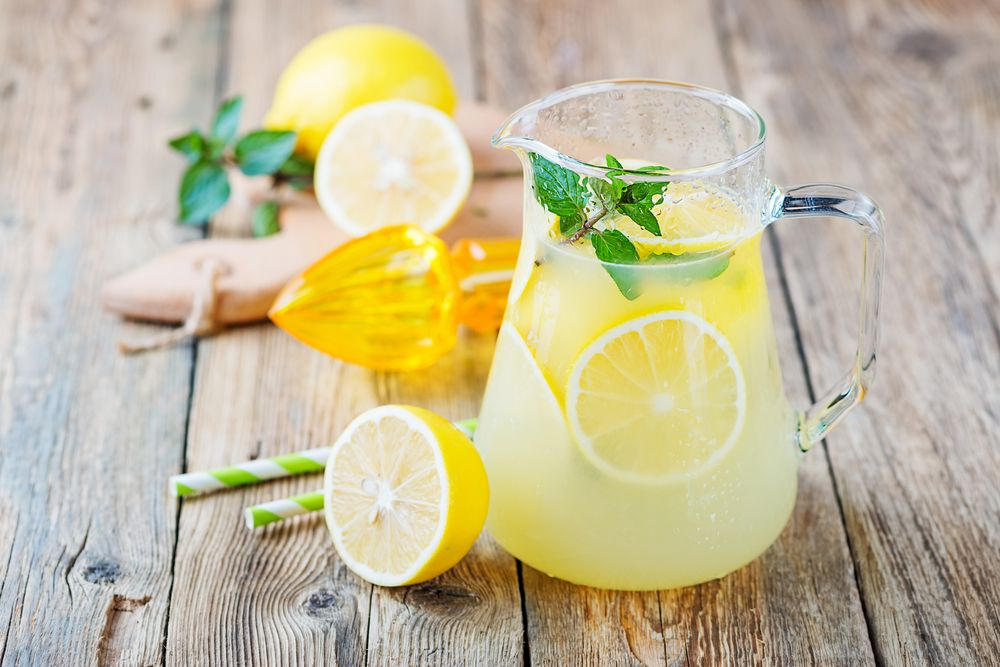 Lemons and lemonade in a pitcher. | Source: Shutterstock