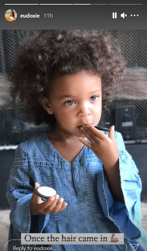 Ludacris' daughter, Cadence, in a denim dress flaunting her full hair   Photo: Instagram/eudoxie